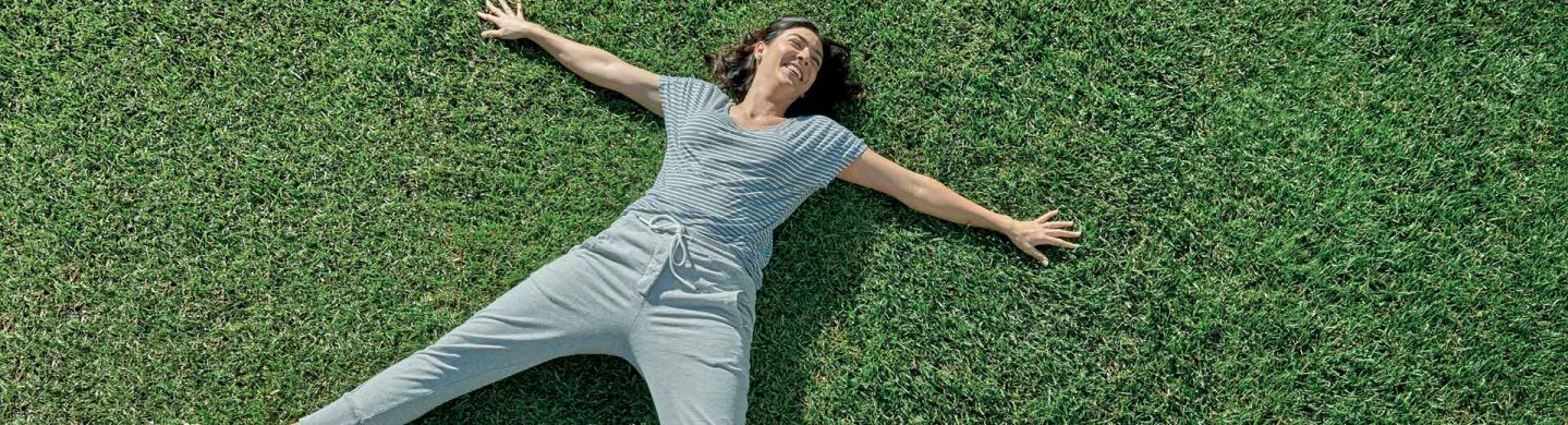 Woman Laying on Sapphire Buffalo Turf