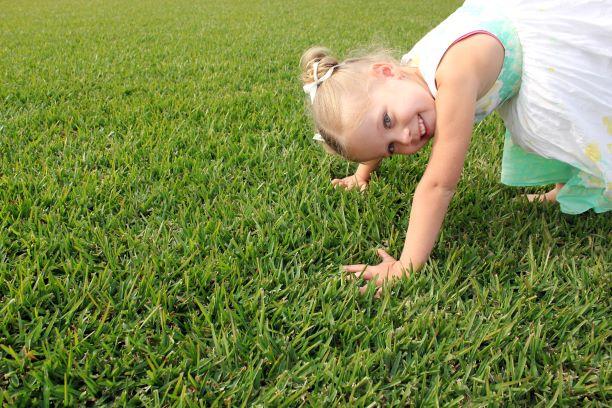 Young Girl Playing on Prestige Buffalo Lawn