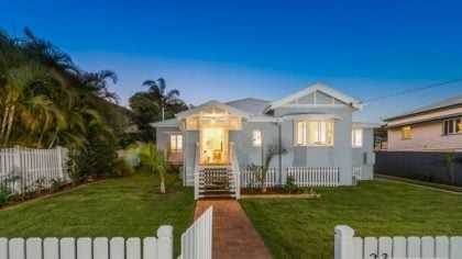 Brisbane Queenslander Home with Green Front Lawn